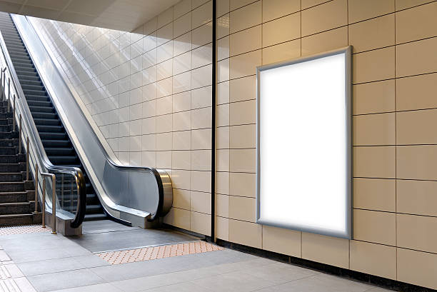 vertical light box poster mockup in metro station. - billboard train station bildbanksfoton och bilder