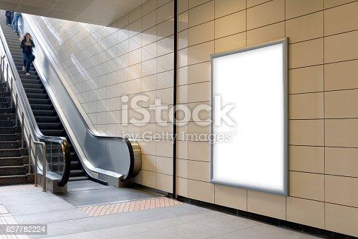 istock Vertical light box poster mockup in metro station. 627782224
