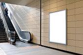 Vertical light box poster mockup in metro station.