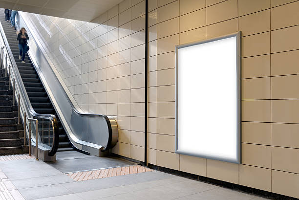 Vertical light box poster mockup in metro station. ストックフォト