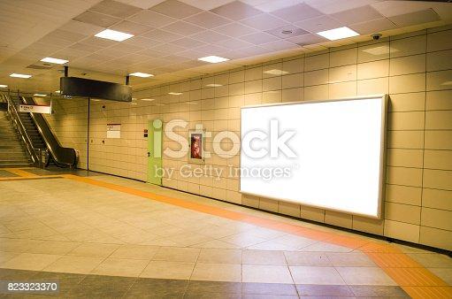 istock Vertical light box poster mockup in metro station 823323370