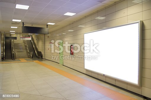 istock Vertical light box poster mockup in metro station 823323490