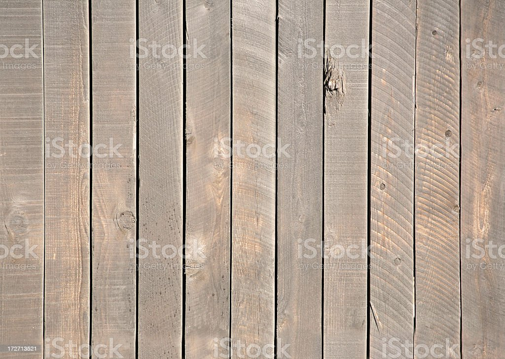 Vertical lined brown wooden fence royalty-free stock photo