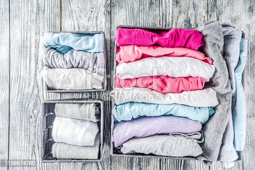 1156676569 istock photo Vertical Marie Kondo tidying clothes method 1156674760
