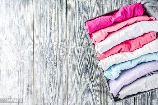 1164403335 istock photo Vertical Marie Kondo tidying clothes method 1156675310