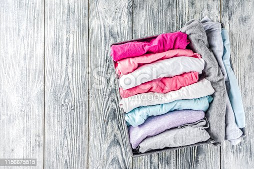 1156676569 istock photo Vertical Marie Kondo tidying clothes method 1156675815