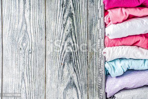 1156676569 istock photo Vertical Marie Kondo tidying clothes method 1156675838