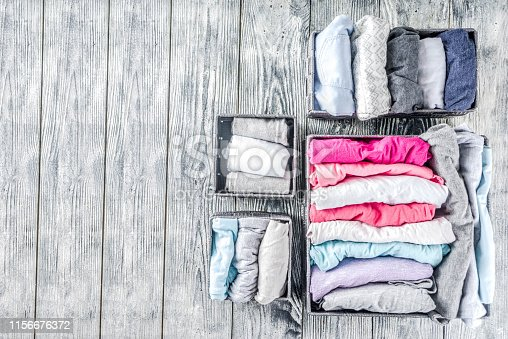 1156676569 istock photo Vertical Marie Kondo tidying clothes method 1156676372