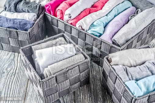 1156676569 istock photo Vertical Marie Kondo tidying clothes method 1156676376