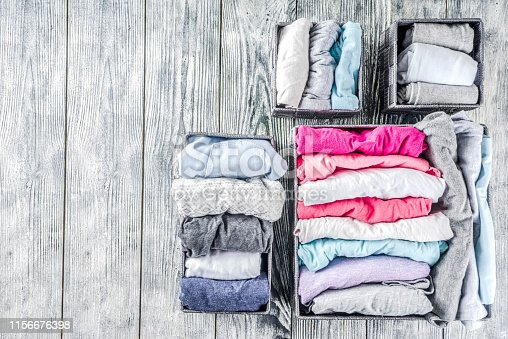 1156676569 istock photo Vertical Marie Kondo tidying clothes method 1156676398