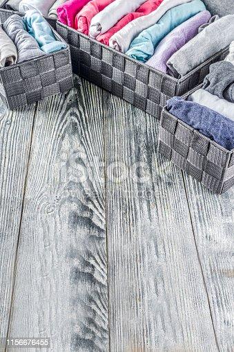 istock Vertical Marie Kondo tidying clothes method 1156676455