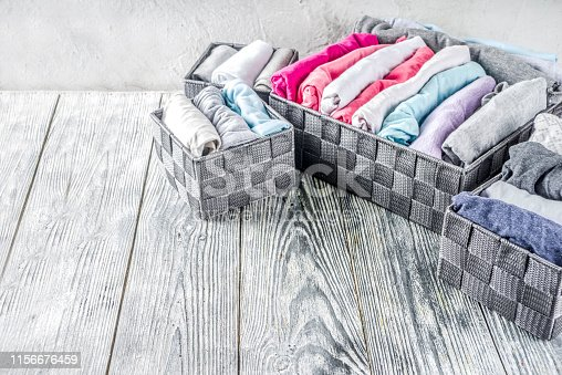1156676569 istock photo Vertical Marie Kondo tidying clothes method 1156676459