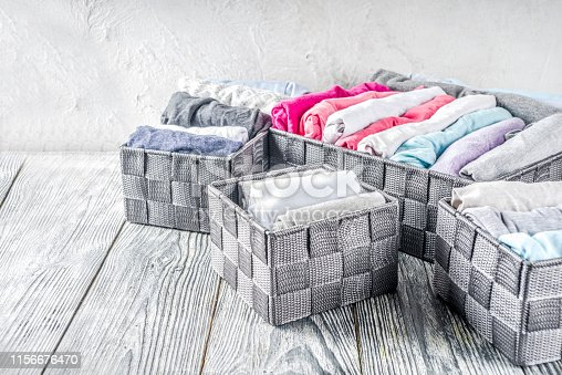 1156676569 istock photo Vertical Marie Kondo tidying clothes method 1156676470