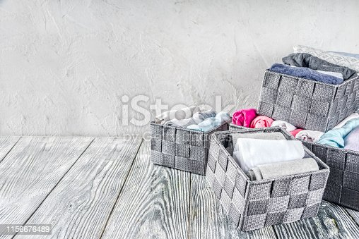 1156676610 istock photo Vertical Marie Kondo tidying clothes method 1156676489
