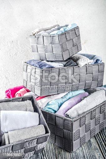 istock Vertical Marie Kondo tidying clothes method 1156676501