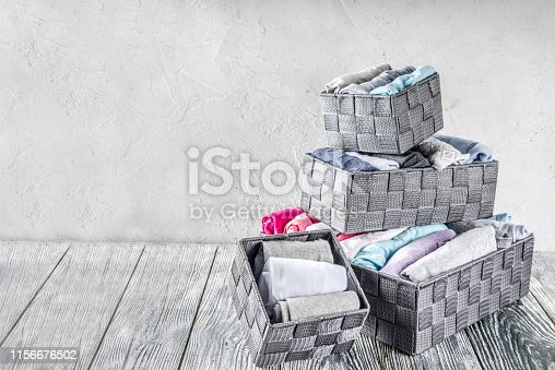 1156676569 istock photo Vertical Marie Kondo tidying clothes method 1156676502