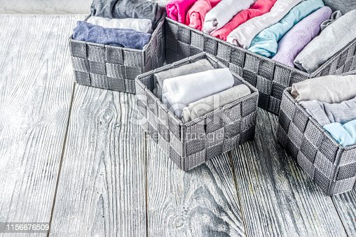 1156676569 istock photo Vertical Marie Kondo tidying clothes method 1156676509