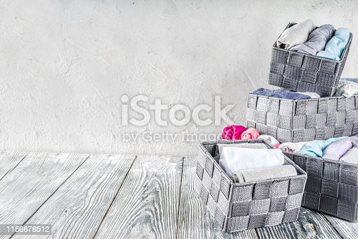 1156676569 istock photo Vertical Marie Kondo tidying clothes method 1156676512