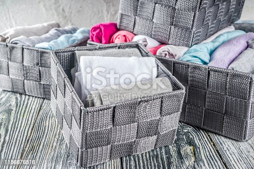 1156676569 istock photo Vertical Marie Kondo tidying clothes method 1156676516