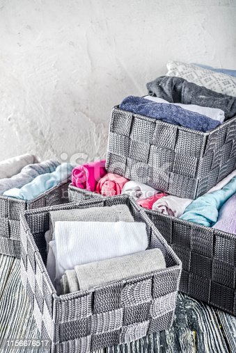 1222867278 istock photo Vertical Marie Kondo tidying clothes method 1156676517
