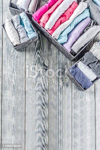 istock Vertical Marie Kondo tidying clothes method 1156676539