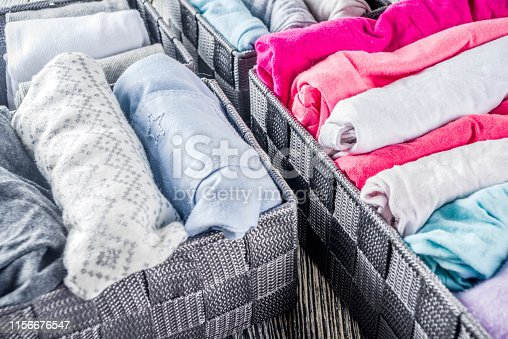 1156676569 istock photo Vertical Marie Kondo tidying clothes method 1156676547