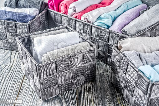 1164401360 istock photo Vertical Marie Kondo tidying clothes method 1156676555