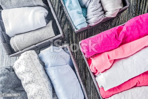 1156676569 istock photo Vertical Marie Kondo tidying clothes method 1156676571