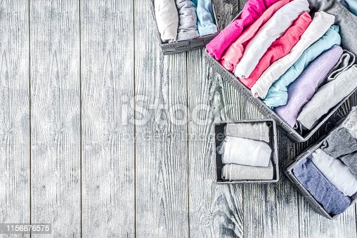 1156676569 istock photo Vertical Marie Kondo tidying clothes method 1156676575
