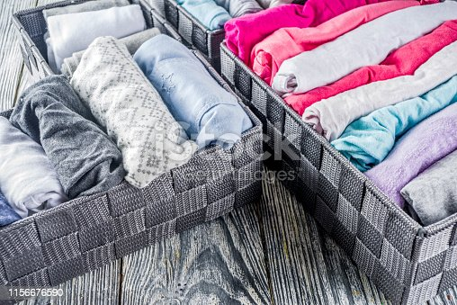 1164401360 istock photo Vertical Marie Kondo tidying clothes method 1156676590