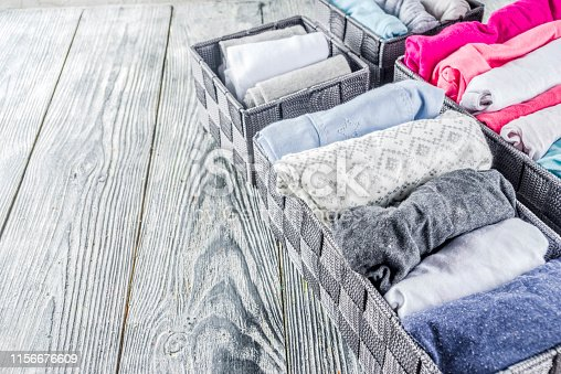 1164401360 istock photo Vertical Marie Kondo tidying clothes method 1156676609