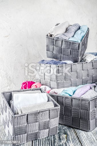 istock Vertical Marie Kondo tidying clothes method 1156676614
