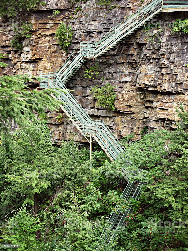 Vertical Photograph of Steep Stairs on Ausable Chasm Rock Layers stock photo