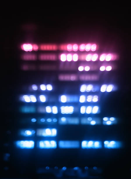 Vertical pink and purple office building illumination bokeh back stock photo