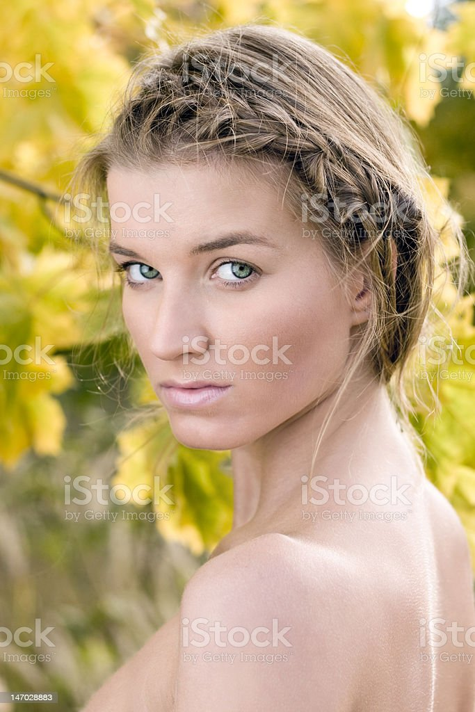 Vertical portrait of a beautiful young women in autumn nature royalty-free stock photo