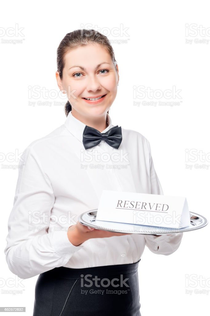 Vertical portrait of a girl of the waiter in shirt and bow tie isolated stock photo