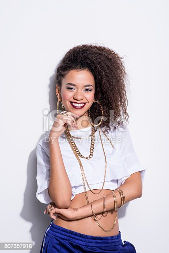 807419930istockphoto Vertical portrait of happy young latin woman in chola style 807357916
