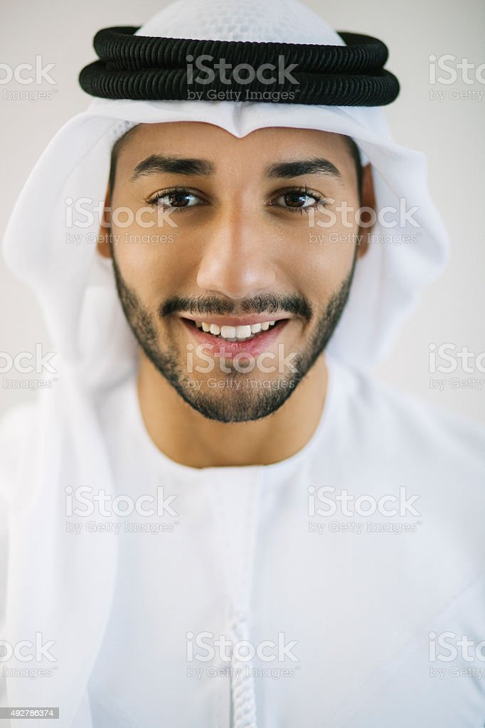 Vertical Portrait of Young Arab Man Dressed in Traditional Clothing stock photo
