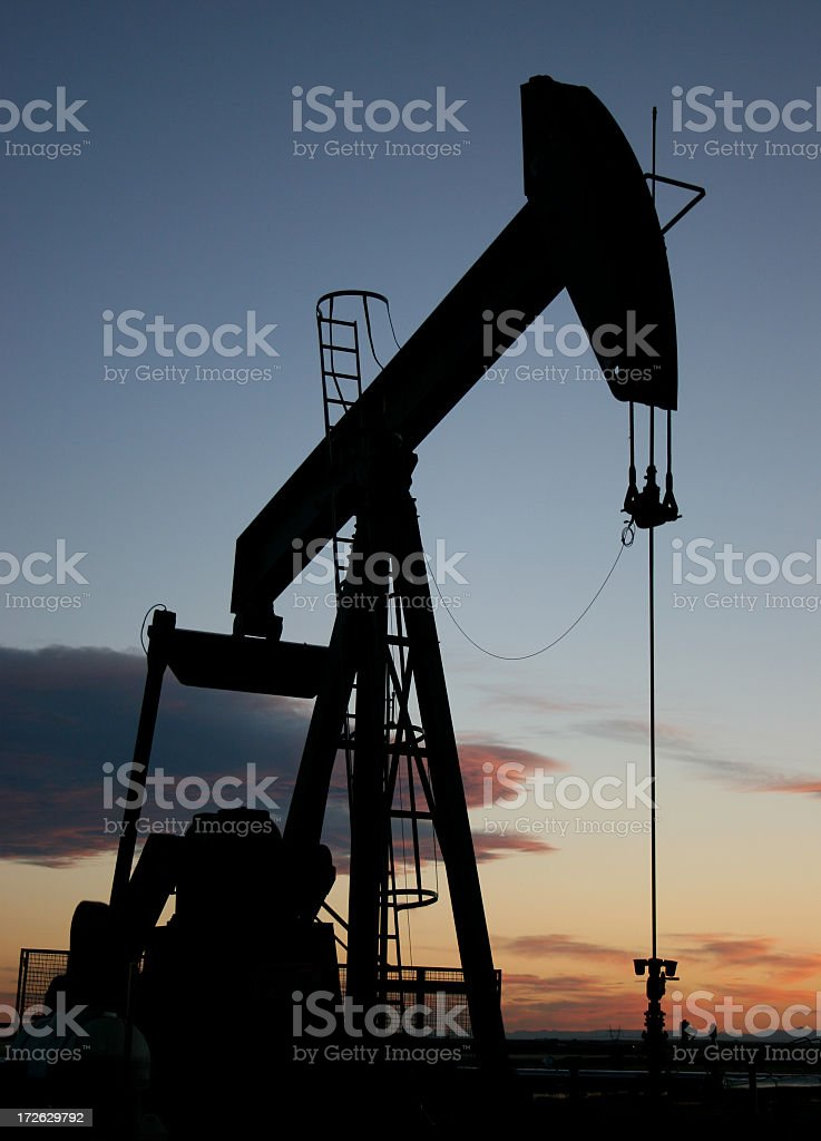 Vertical Pumpjack Silhouette in Alberta Canada Oil Industry royalty-free stock photo