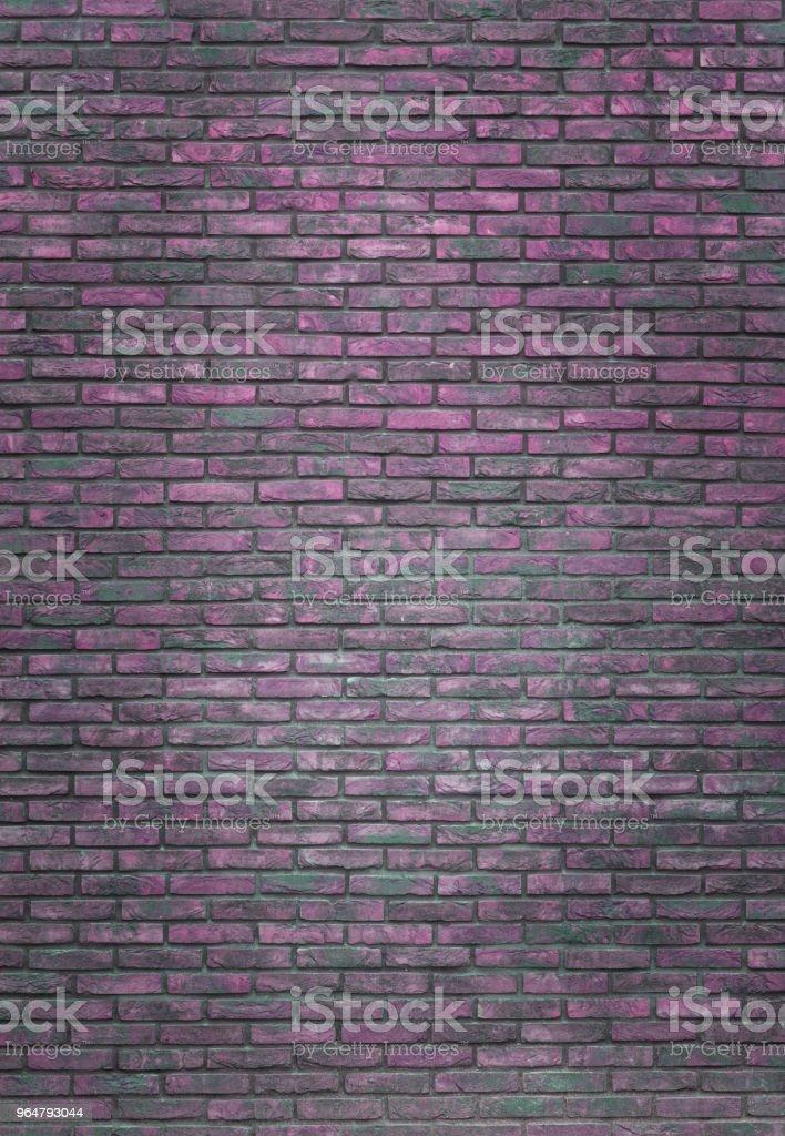 Vertical purple brick wall background, wallpaper. Purple bricks pattern, texture royalty-free stock photo