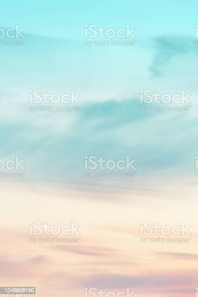 Photo of Vertical ratio size of sunset background. sky with soft and blur pastel colored clouds. gradient cloud on the beach resort. nature. sunrise.  peaceful morning.