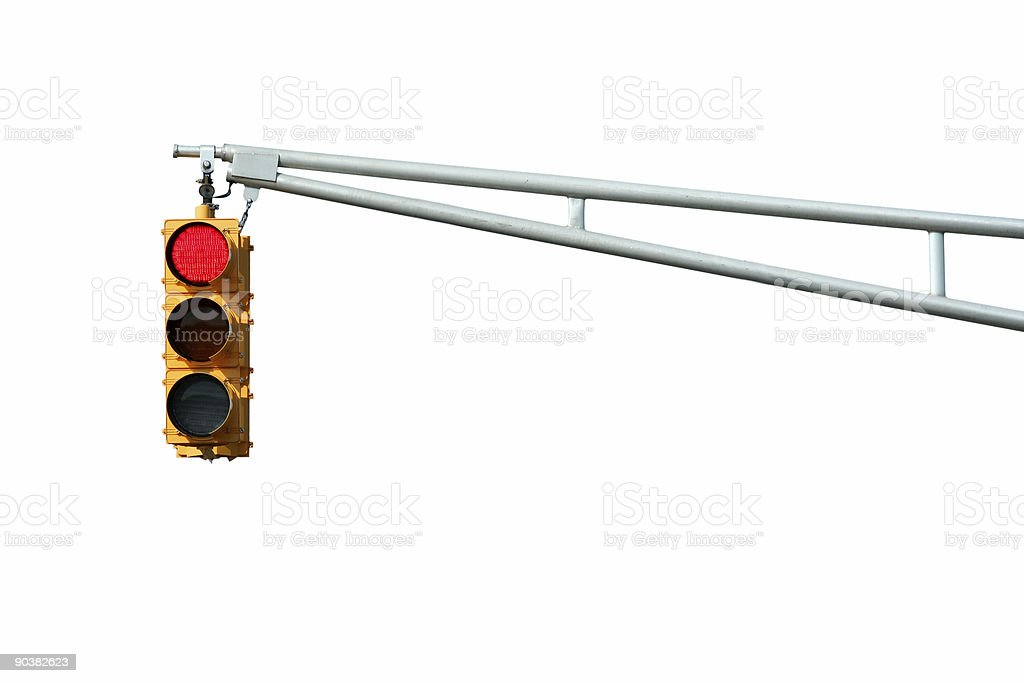 Vertical red traffic light on white background stock photo