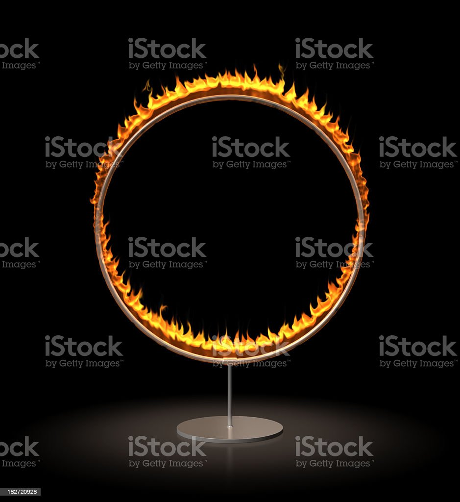 A vertical ring of fire stands against a black background stock photo