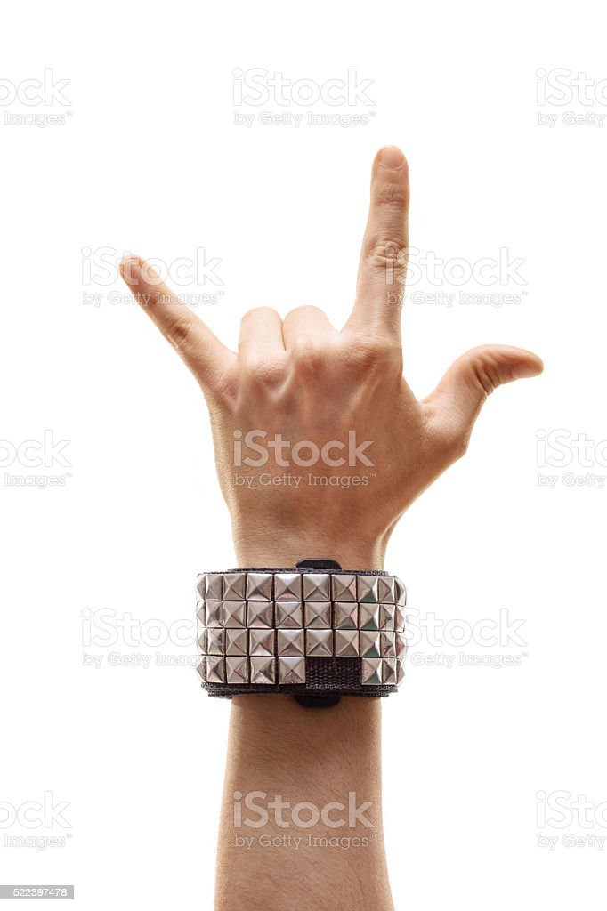 Vertical shot of a hand making rock sign stock photo