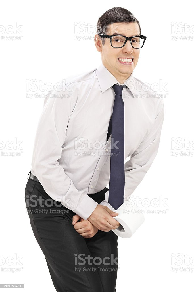 Vertical shot of a man needing to urinate stock photo