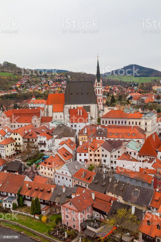 Vertical shot of Cesky Krumlov with Saint Vitus Church. Cloudy spring weather. UNESCO World Heritage Site stock photo