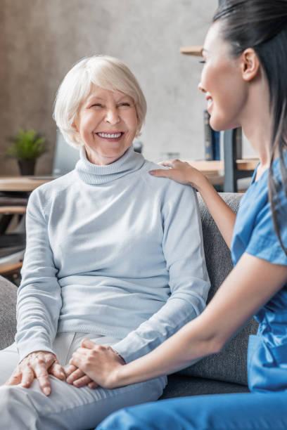 Vertical shot of helpful nurse taking care of senior woman in nursing picture id1181670575?b=1&k=6&m=1181670575&s=612x612&w=0&h=dokbwhvdycdqrpafugzcftw0eaa kjmkt8ffyta5gh0=