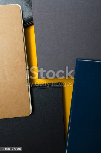 istock Vertical shot of lightning shape made of books.Concept of creating of ideas and education or business plans 1199178236