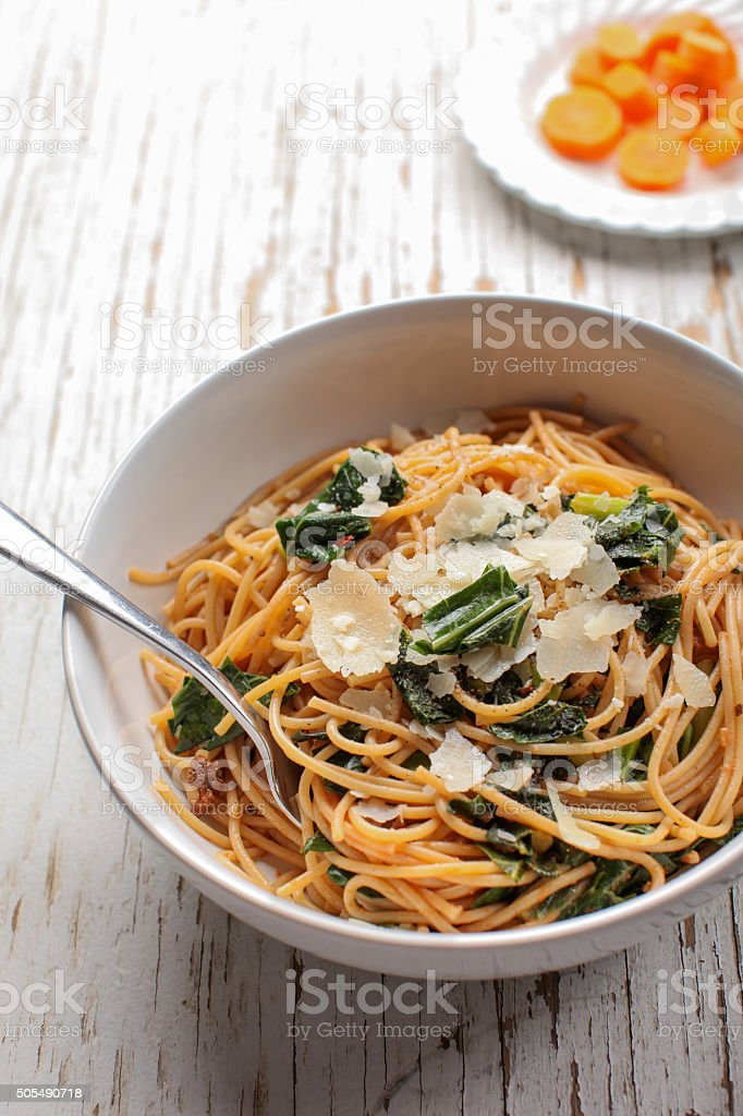 Vertical shot of pasta dish with carrots stock photo