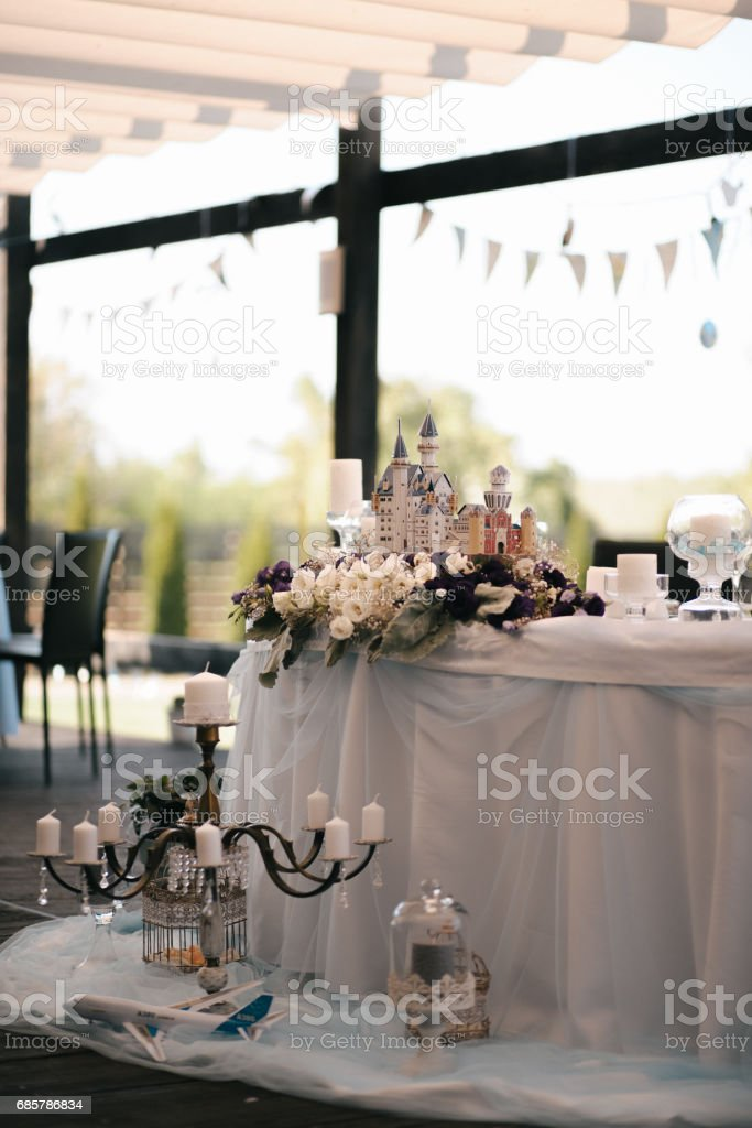 Vertical shot of wedding table decoration elements for a nice lovely banquet royalty-free stock photo